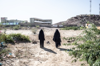 Yemen, Mawza, 13 December 2018 – Two women are walking towards the school of Mawza. Mawza is located in Mocha district, Taiz governorate, a 45 minutes-drive to the east of Mocha city. This is a very poor and rural area, people are depending on their land to eat and to earn money. The area was taken over from Ansar Allah's control by forces loyal to President Hadi, supported by the Saudi and Emirati-led coalition, in the beginning of 2018. Fighting damaged the fields and thus, the livelihood of the 13,000 inhabitants of Mawza. While military troops were withdrawing, thousands of landmines and improvised explosive devices (IED) were planted in the area. Between August and December, MSF teams in Mocha received around 150 people injured by landmines or IED, mainly children playing in the fields.