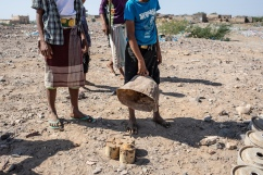 Yemen, Mawza, 13 December 2018 – A child is showing three IEDs. Mawza is located in Mocha district, Taiz governorate, a 45 minutes-drive to the east of Mocha city. This is a very poor and rural area, people are depending on their land to eat and to earn money. The area was taken over from Ansar Allah's control by forces loyal to President Hadi, supported by the Saudi and Emirati-led coalition, in the beginning of 2018. Fighting damaged the fields and thus, the livelihood of the 13,000 inhabitants of Mawza. While military troops were withdrawing, thousands of landmines and improvised explosive devices (IED) were planted in the area. Between August and December, MSF teams in Mocha received around 150 people injured by landmines or IED, mainly children playing in the fields. Landmines and IEDs are defused by military forces. Local NGOs are in charge of locating these devices.